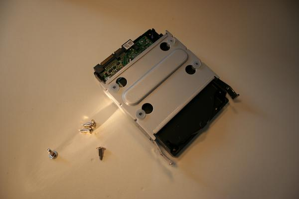 Attaching the hard drive to the mounting plate